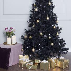 Ottawa plastgran miljöbild med julklappar delad bild