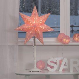Adventsstjärna Romantic rosa på fot på bord